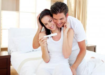 Enamored couple finding out results of a pregnancy test